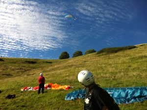 Paragliders on the countryside hill