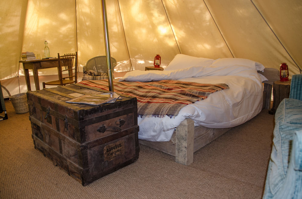 A bed inside of a yurt