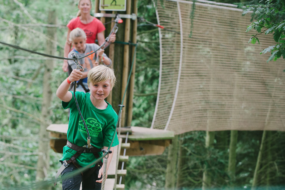 Children playing on tightrope at Go Ape