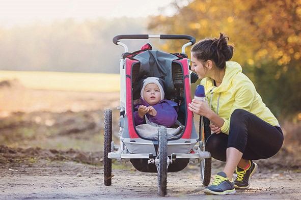 Mother and baby on countryside hike with buggy