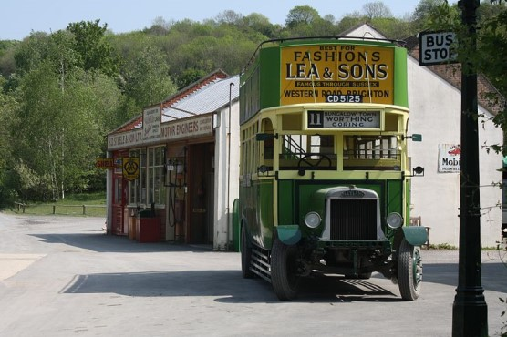 Amberley Museum old fashioned green and yellow double decker bus with open top