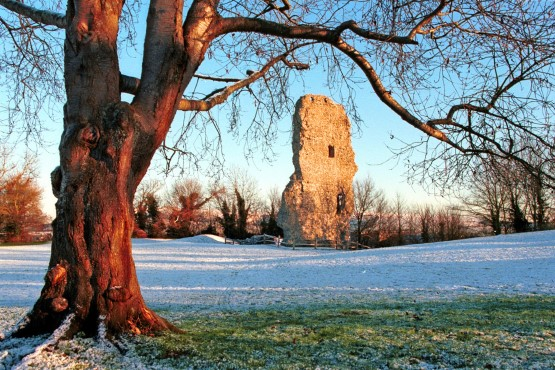 Bramber castle in the winter with snow on the grass