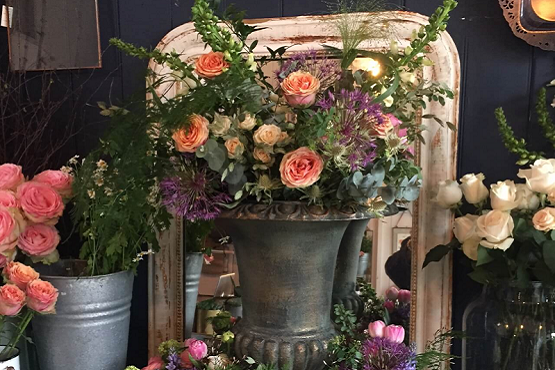 Antique urn filled with flowers at Cuckfield's independent shops