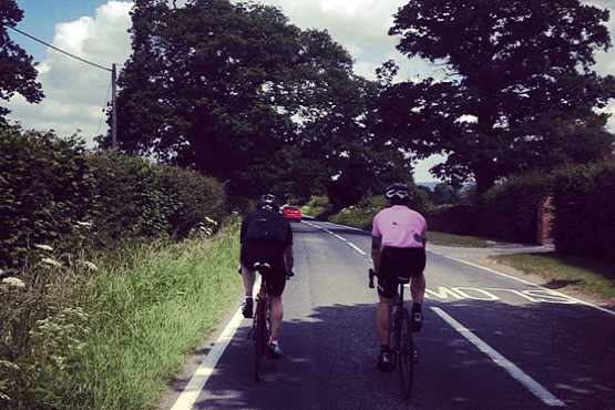 Cyclists on the Bignor Beacon road