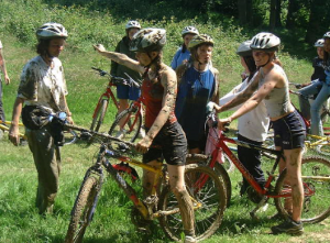 A group of muddy cyclists