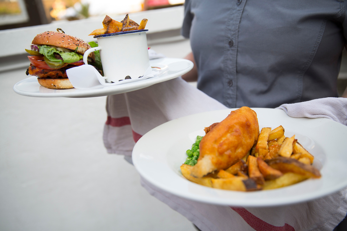 Burger and fish and chips on a plate