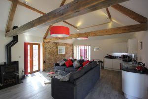 Open beams in the living area of Flinstone cottage