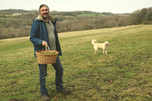 Foraging in West Sussex man with dog and basket of foraged goods
