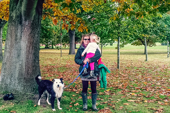 Family walk in the park with dog