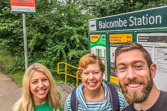 Luke and family in front of Balcombe Station sign
