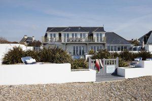 New England Beach House on pebbles