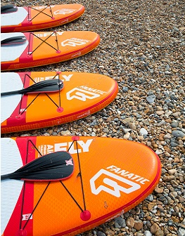 Paddle boarding at the beach in West Sussex