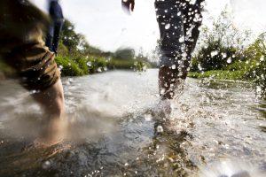 People splashing in river