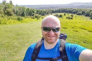 A man taking a selfie in a field