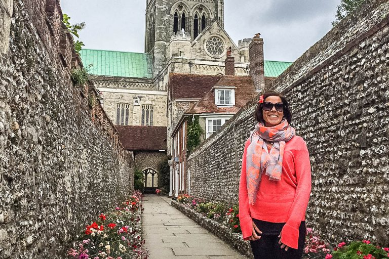 Woman posing by Chichester cathedral