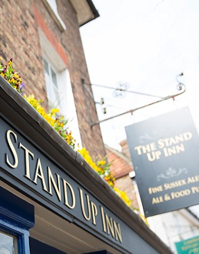 The Stand Up Inn sign