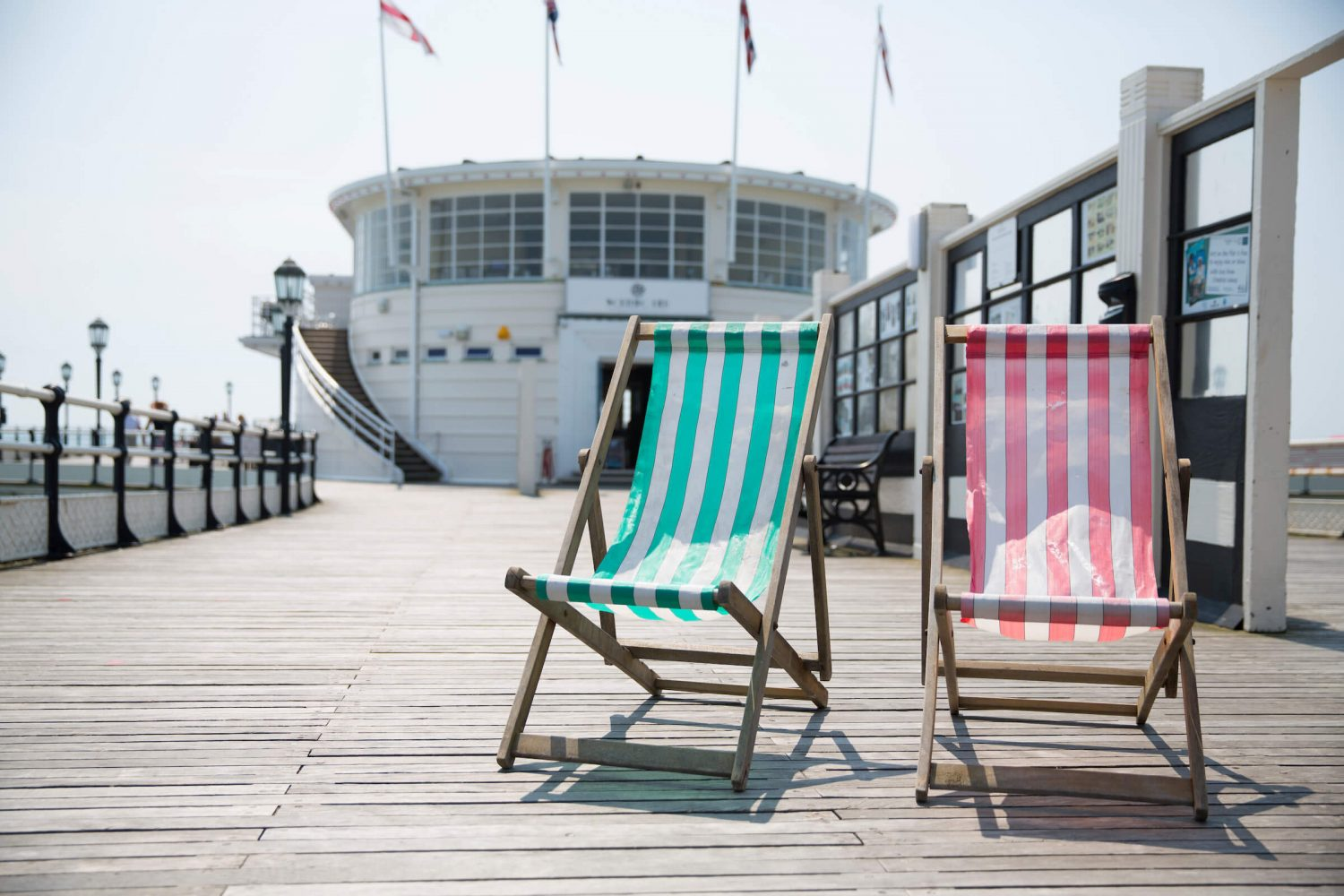 Two deck chairs on Worthing Pier