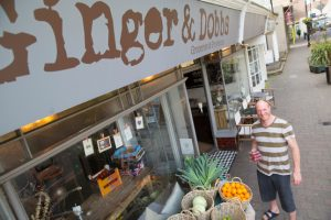 A customer in front of Ginger and Dobbs grocery store in Shoreham-by-Sea, West Sussex