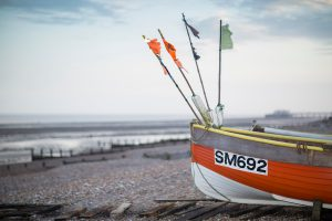 Boat on pebbles at Worthing beach