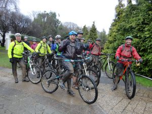 Muddy cyclists on a guided ride