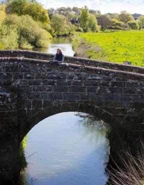 Brick bridge over countryside river