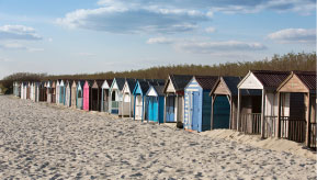 Beach huts on sandy beach