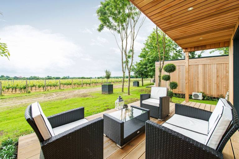 Outdoor seating of the Tinwood Lodges