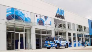 The front of the Air Arena with blue camo vehicle outside