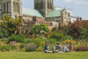 Young adults sitting in park in Chichester