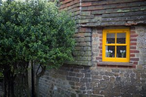 Midhurst old building and tree with yellow window