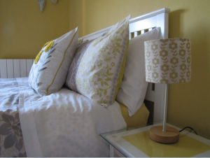 A picture of the top of a bed with pillows in a guest room at Hill View accommodation