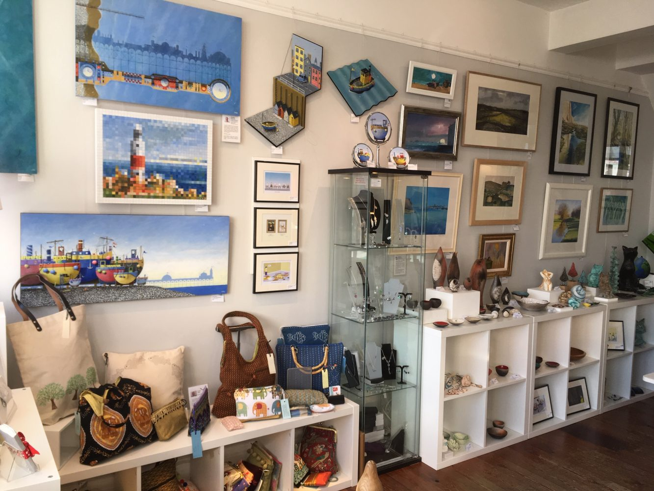 The interior of Shoreham Art Gallery showing pictures, crafts and objects