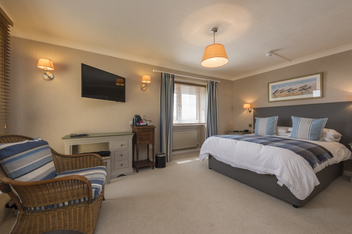 A guest bedroom at The Beachcroft Hotel