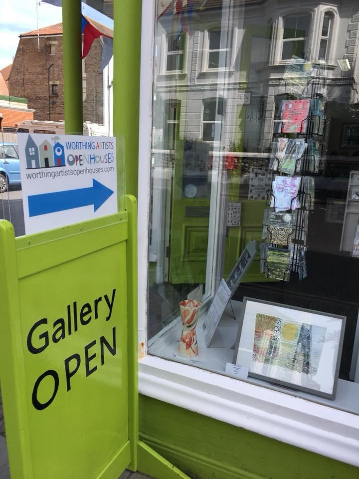 Art gallery sign outside shop
