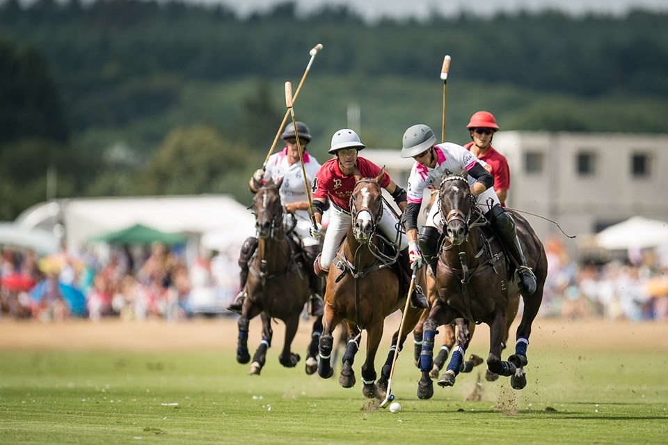 Four polo players on horses at Cowdray Park Polo