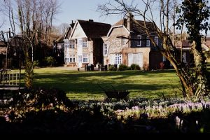 The grounds and outside of the Findon Manor Hotel with bluebells