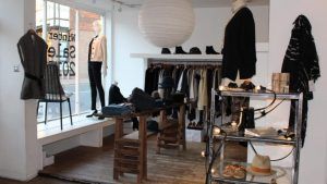 Inside of Neilson Boutique showing a collection of fashion and accessories