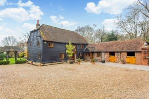 A renovated cladded barn and outbuildings in Sussex providing luxury accommodation for famileis and groups