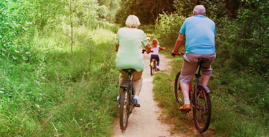 Family cycling down Henfield Downs Link