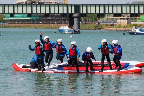 A group of children jumping into the water at the Adur Centre in Sussex