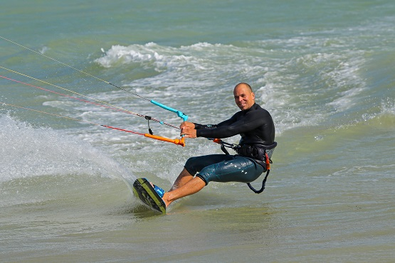 Lewis Crathern kitesurfing on the water in Sussex