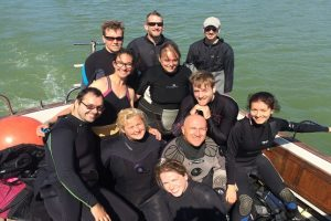 A group of divers on the boat after diving for oysters