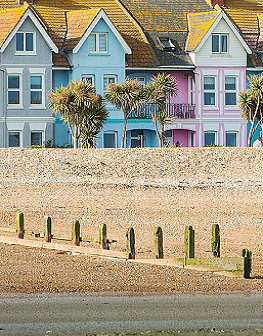 Pebbled beach landscape with colourful houses in Worthing West Sussex