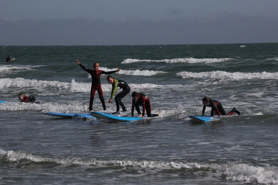 Children learning to surf in West Sussex