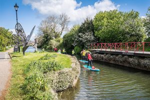 A group paddleboarding on the the river in Chichester