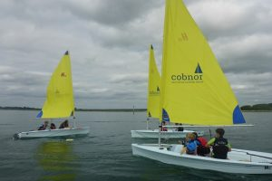 Three boats on the water at the Cobnor Acitivities Centre