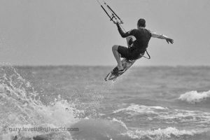 Black and white image of a kite boarder on the sea in West Sussex
