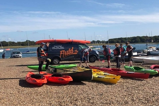 A group ready for a kayaking lesson with Fluid Adventures in West Sussex