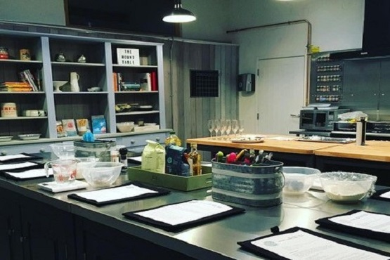 A kitchen ready for a cookery lesson at the Round Table Cookery school in Haywards Heath