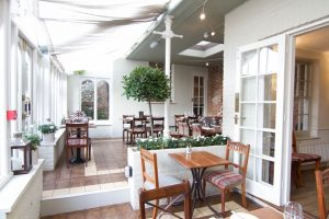 Dining room with tables and chairs at the Field and Fork in Chichester